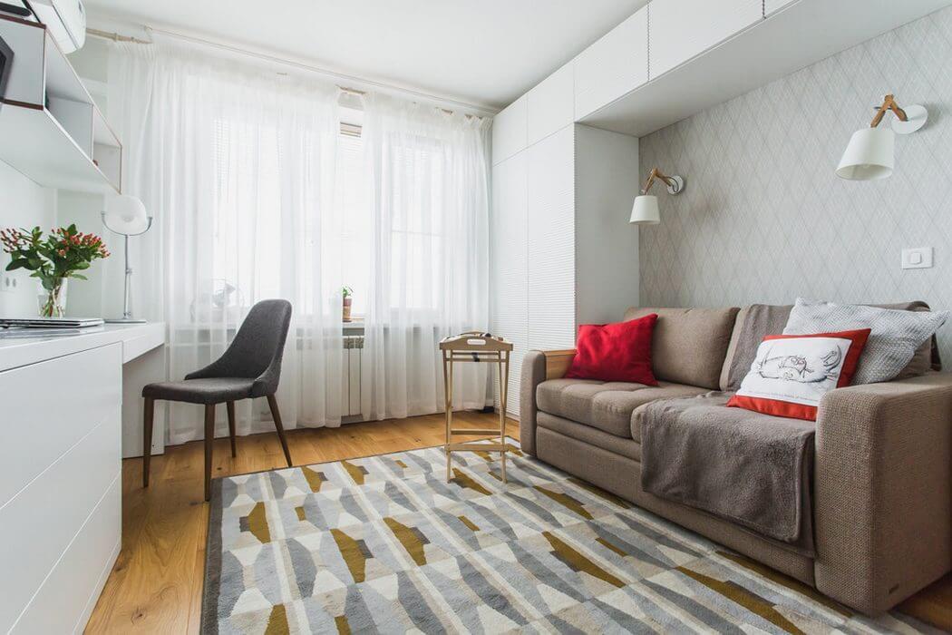 интерьер спальни с диваном в современном стиле