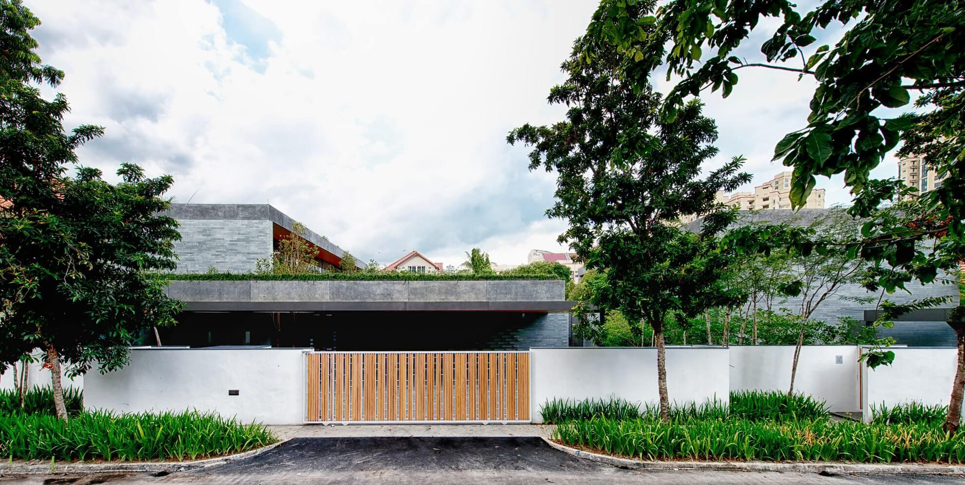 Дом The Wall House в Сингапуре